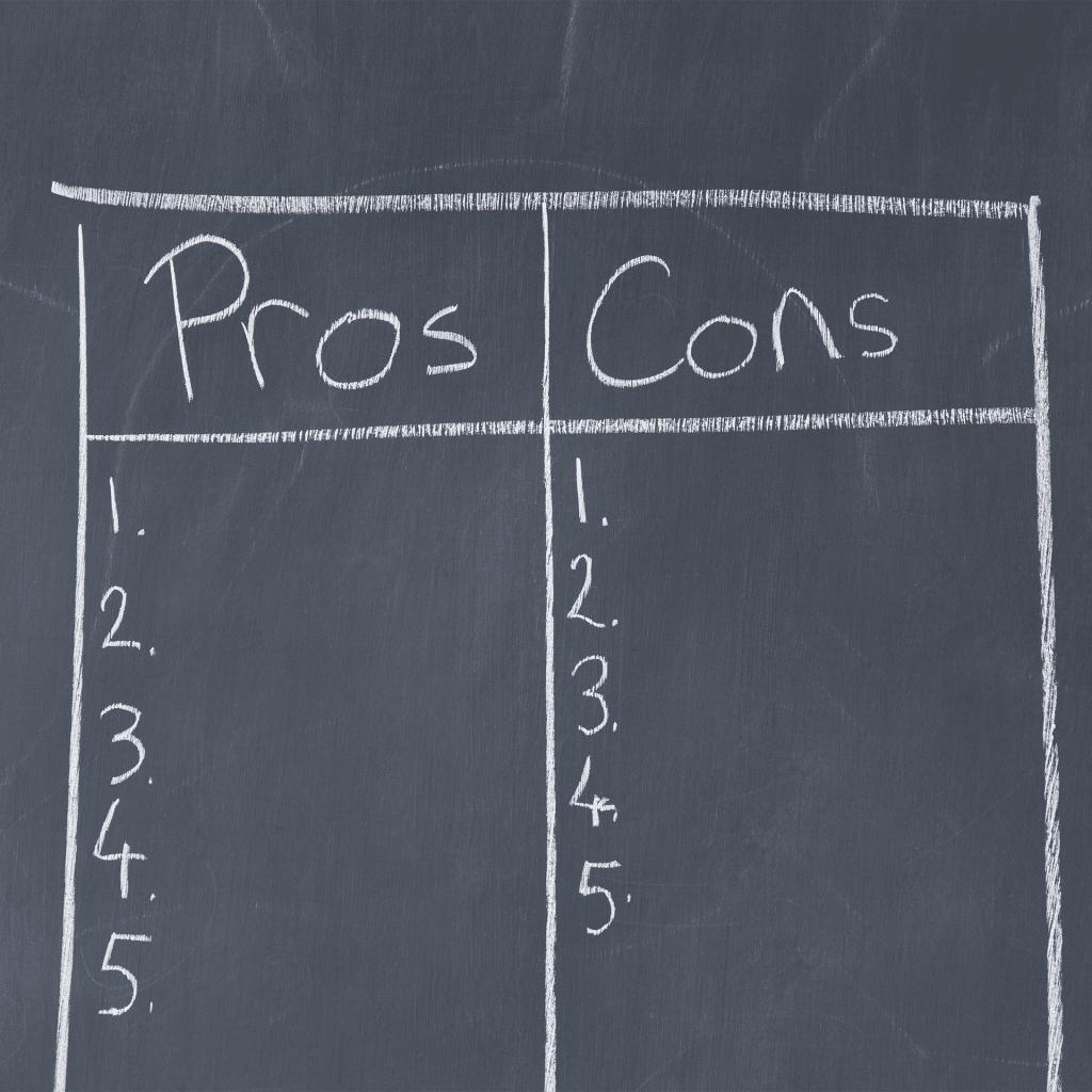 chart with pros and cons on a board